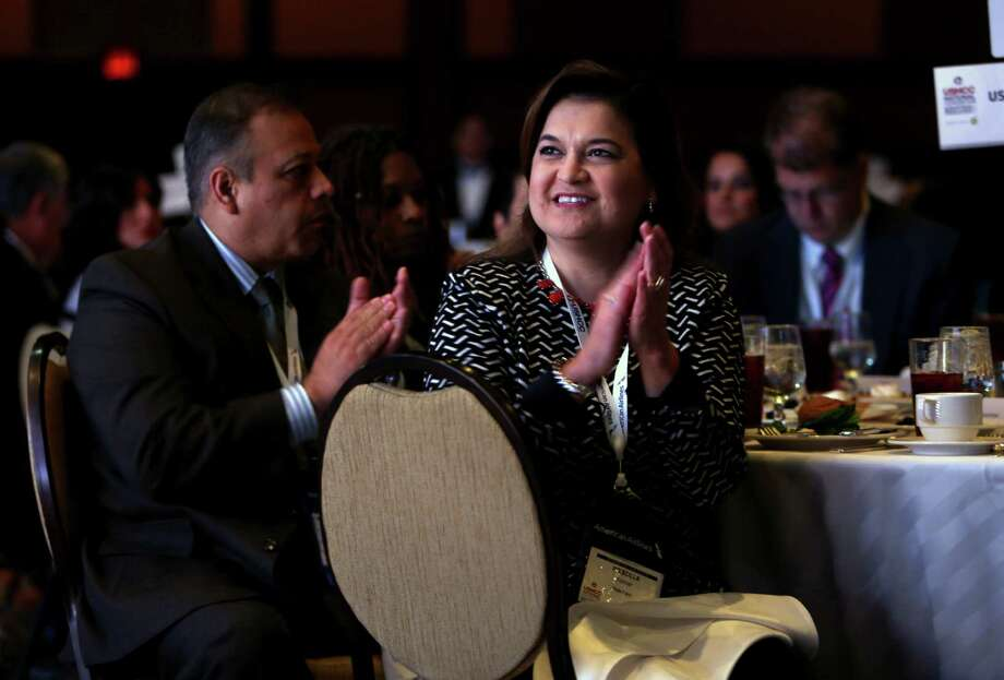 Pricilla Escobar of State Farm applauds Monday while former Florida Gov.  Jeb Bush addresses the U.S. Hispanic Chamber of Commerce. He spoke against Donald Trump on immigrant issues. Story on Page B2. Photo: Gary Coronado, Staff / © 2015 Houston Chronicle