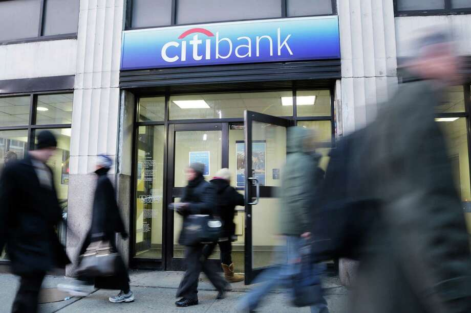 In this Thursday, Jan 15, 2015 photo, people walk past a branch office of Citibank, in New York. Citigroup said Thursday, April 16, 2015, its first-quarter net income rose 21 percent as the company continued to slim down its operations and control expenses. (AP Photo/Mark Lennihan) ORG XMIT: NY115 Photo: Mark Lennihan / AP