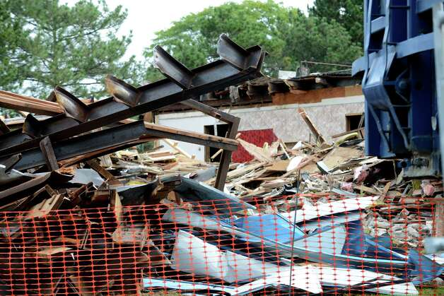 The front half of the Wolf Rd. Diner is demolished to make way for Warehouse Grill & BBQ Monday morning, Sept. 21, 2015, at 219 Wolf Road in Colonie, N.Y. The diner was open for 28 years before founder/owner Dennis Spathis closed it when he retired in June. The rear half of the building will remain and be adapted for kitchen, prep, storage and office space. (Will Waldron/Times Union) Photo: Will Waldron