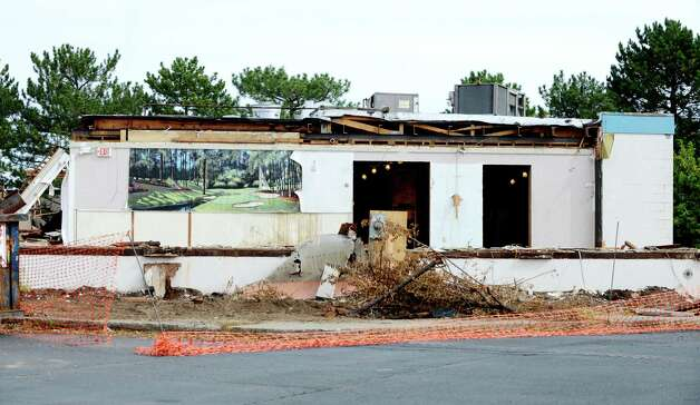 An open side of the Wolf Rd. Diner facing Ulenski Dr. is exposed after demolition to make way for Warehouse Grill & BBQ Monday morning, Sept. 21, 2015, at 219 Wolf Road in Colonie, N.Y. The diner was open for 28 years before founder/owner Dennis Spathis closed it when he retired in June. The rear half of the building will remain and be adapted for kitchen, prep, storage and office space. (Will Waldron/Times Union) Photo: Will Waldron