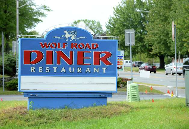 Sign outside the Wolf Rd. Diner Monday morning, Sept. 21, 2015, at 219 Wolf Road in Colonie, N.Y. The the front half of the diner is being demolition to make way for Warehouse Grill & BBQ. It was open for 28 years before founder/owner Dennis Spathis closed it when he retired in June. The rear half of the building will remain and be adapted for kitchen, prep, storage and office space. (Will Waldron/Times Union) Photo: Will Waldron
