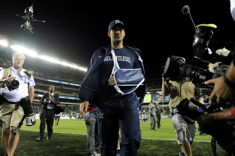 injured Dallas Cowboys quarterback Tony Romo walks off the field after an NFL football game against the Philadelphia Eagles, Sunday, Sept. 20, 2015, in Philadelphia. Dallas won 20-10. Photo: Michael Perez /Associated Press / FR168006 AP