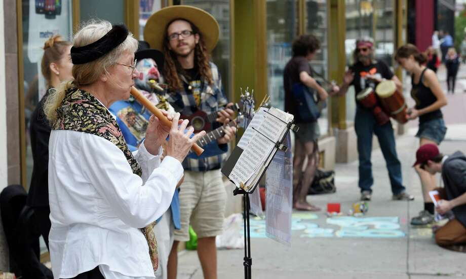 Recorder artist Laura Hagen joins other buskers during a rally of and for buskers on North Pearl Street Monday afternoon Sept. 21, 2015 in Albany, N.Y.        (Skip Dickstein/Times Union) Photo: SKIP DICKSTEIN / 00033360A