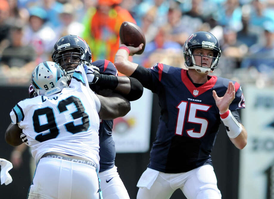 Houston Texans' Ryan Mallett (15) looks to pass under pressure from Carolina Panthers' Kyle Love (93) during the first half of an NFL football game in Charlotte, N.C., Saturday, Sept. 19, 2015. Photo: Mike McCarn /Associated Press / FR34342 AP
