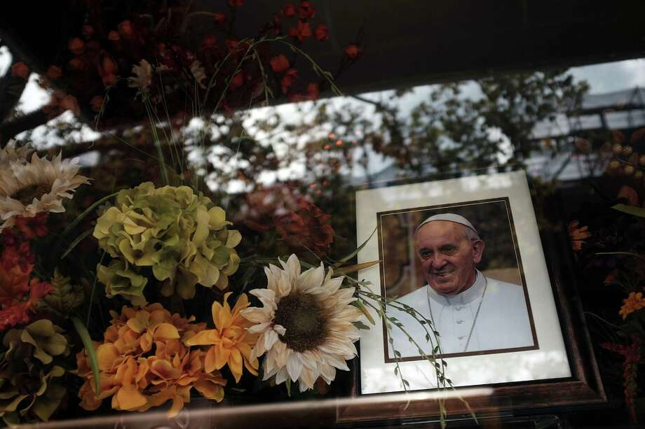 A  portrait of Pope Franics sits in a window near Our Lady Queen of Angels School in East Harlem where Pope Francis is scheduled to visit in New York. Photo: Spencer Platt, Staff / 2015 Getty Images