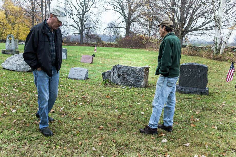 Mark, left, and Sam Averill visit the grave of their mother, Jean, in Washington. Jean Averill was among the victims linked to the General Motors ignition switch defect. Photo: Misha Friedman / New York Times / NYTNS