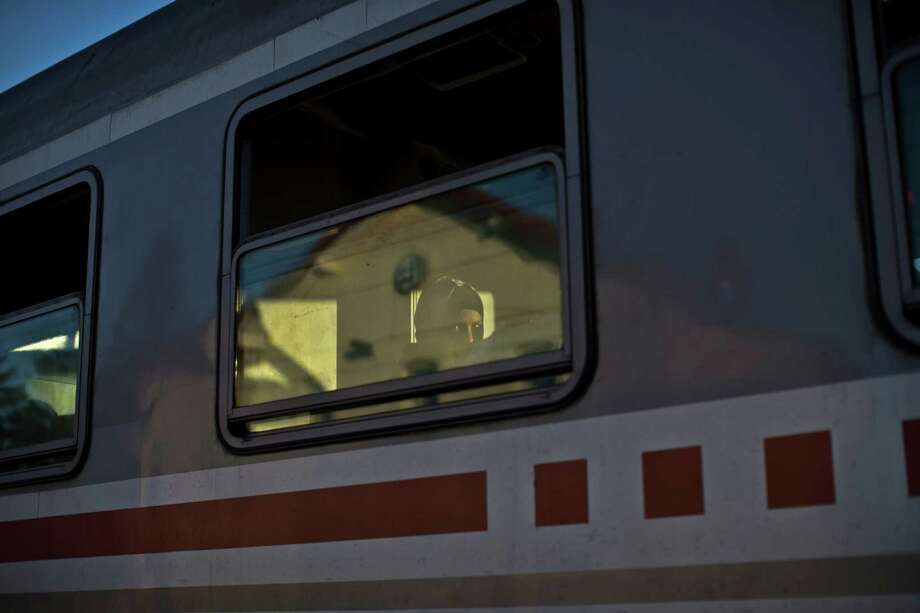 A woman looks through the window of a train she boarded with other migrants and refugees, close to Croatia's border with Serbia, in Tovarnik, Croatia, Monday, Sept. 21, 2015. Croatia has been under extreme pressure since thousands of asylum seekers got stuck there after Hungary shut its border last week. (AP Photo/Marko Drobnjakovic) ORG XMIT: XMD110 Photo: Marko Drobnjakovic / AP