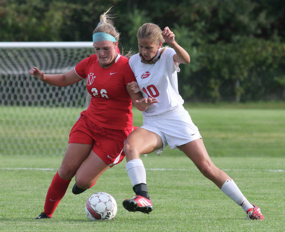 Niskayuna's Hannah Munro (26) battles for control of the ball against Guilderland's Amanda Rice during Monday's Suburban Council girls soccer matchup at Guilderland High School. (Ed Burke / Special to the Times Union)