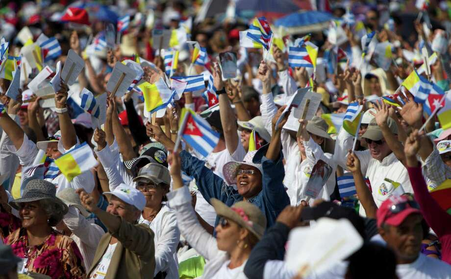 Thousands greet Pope Francis as he arrives to celebrate Mass at the Plaza of the Revolution in Holguin, Cuba, Monday, Sept. 21, 2015. Holguin's plaza was packed with people waving flags as Francis traveled in his popemobile through the crowd. (Ismael Francisco/Cubadebate Via AP) ORG XMIT: XIF101 Photo: Ismael Francisco / Cubadebate