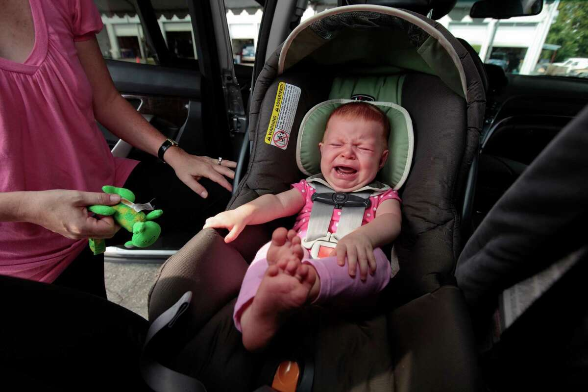 New safety guidelines recommend keeping infants in rear-facing car seats an extra year, to age 2, but some parents say the babies already cry facing backward as mom Michelle Moore is finding out with her daughter, Gracen.
