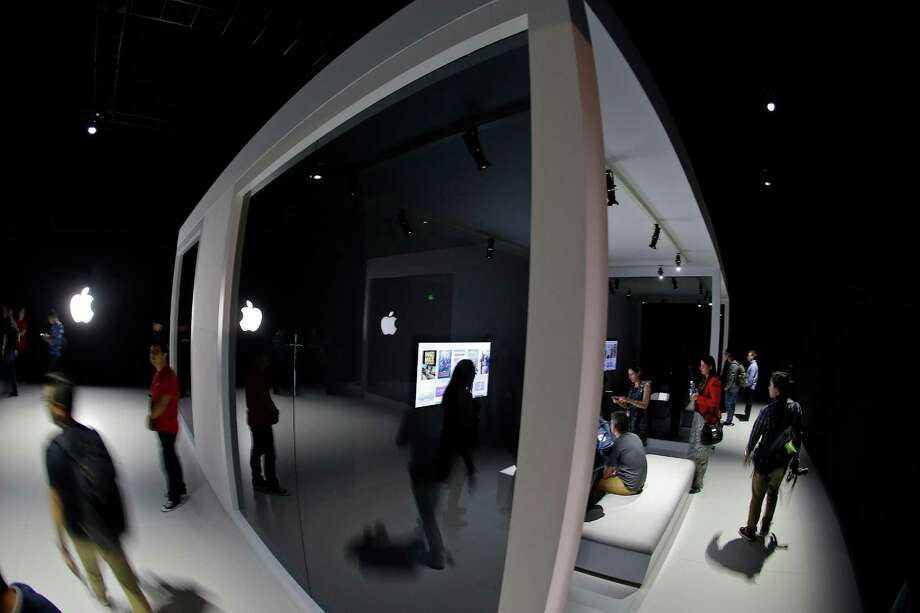 Visitors experience the new Apple TV system on Sept. 9 during a product display after Apple's event in San Francisco. The new Apple TV will be available at the end of October for $149 for the 32GB version or $199 for 64GB. Photo: Eric Risberg, STF / AP