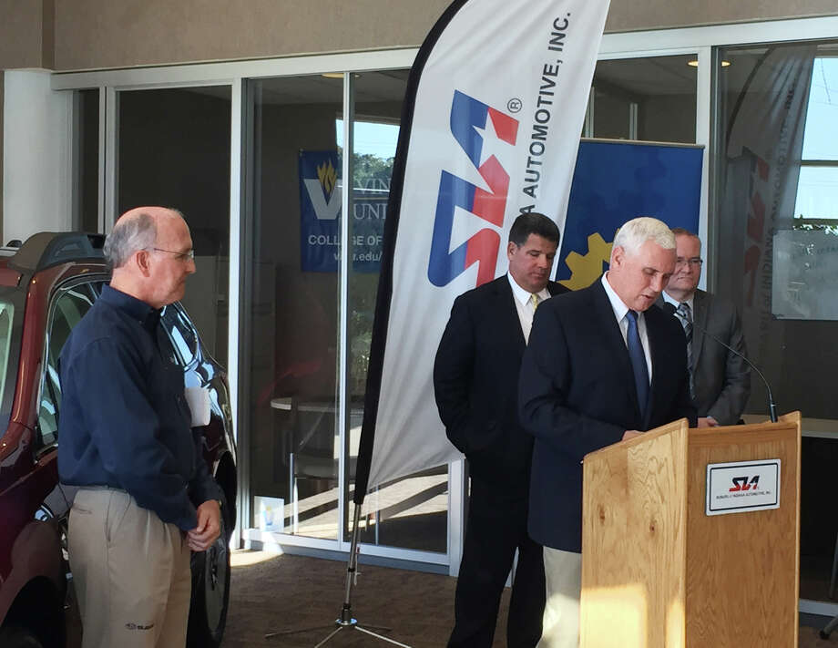 Gov. Mike Pence, right, comments on the expansion of the Subaru of Indiana Automotive Inc. plant Monday, Sept. 21, 2015, in Lafayette, Ind. Tom Easterday, left, SIA executive vice president, announced the company will invest $140 million to expand the plant and increase production capacity by 100,000 vehicles a year. (Dylan Peers McCoy/Journal & Courier via AP) Photo: Dylan Peers McCoy, MBO / Jorunal & Courier