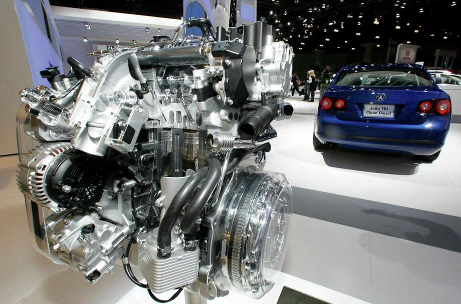 """The """"clean"""" diesel engine of the 2009 Volkswagen Jetta TDI earned two green energy awards, which the company was asked on Wednesday to return. diesel engine is displayed at the Los Angeles Auto Show. Green Car Journal named Volkswagen's 2009 Jetta TDI as the """"Green Car of the Year"""" at the show on Thursday, making it the first clean-diesel vehicle to win the prize. Around 15 billion euros (US$ 16.9 billion) was wiped off the market value of Volkswagen AG on Monday, Sept. 21, 2015 following revelations that the German carmaker rigged U.S. emissions tests for about 500,000 diesel cars. (AP Photo/Damian Dovarganes) Photo: Damian Dovarganes, STF / AP"""