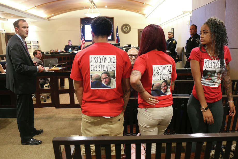 Bexar County Prosecutor David Lunan, left, objects to family members wearing tee-shirts in support of their father, Glen Leon Dukes, during Dukes' capital murder trial in the Bexar County 379th Criminal District Court before Judge Ron Rangel, Monday, Sept. 21, 2015. Dukes, 46, a convicted pimp who currently is serving two life sentences for a trafficking conviction, faces an additional sentence of life without parole if convicted of the 2012 capital murder of Jacqueline Johnson, 24. The siblings are from left, Roosevelt Jackson, LaRita Dukes and Jessica Dukes. Photo: JERRY LARA, Staff / San Antonio Express-News / © 2015 San Antonio Express-News