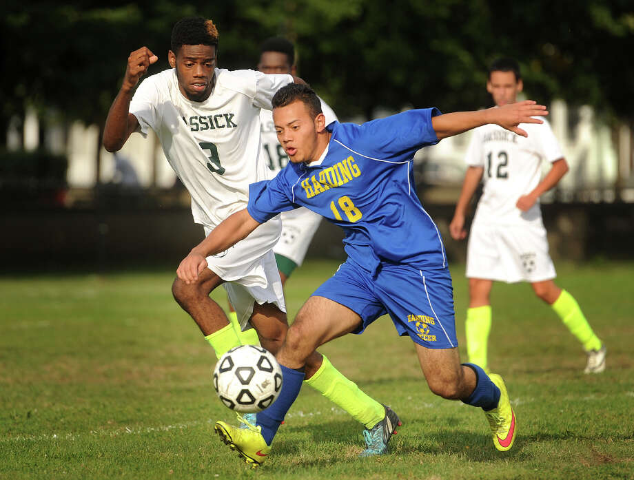 Harding's David Marquin plays the ball in front of Bassick defender Sachin Manning during their soccer matchup Monday at Went Field in Bridgeport. The teams played to a 1-1 tie. Photo: Brian A. Pounds / Hearst Connecticut Media / Connecticut Post