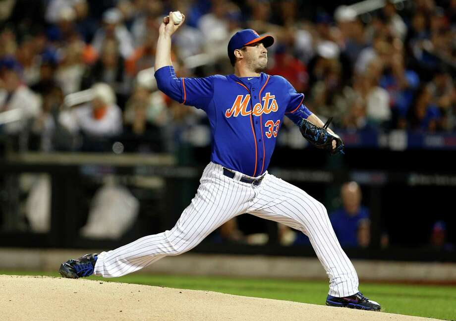 NEW YORK, NY - SEPTEMBER 20: Matt Harvey #33 of the New York Mets pitches during the first inning against the New York Yankees at Citi Field on September 20, 2015 in the Queens borough of New York City. (Photo by Adam Hunger/Getty Images) ORG XMIT: 538595223 Photo: Adam Hunger / 2015 Getty Images
