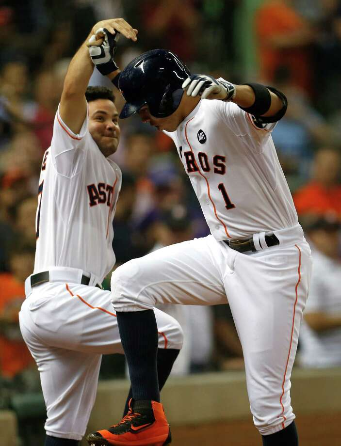 Astros shortstop Carlos Correa (1), a day shy of his 21st birthday, celebrates his 19th homer of the season, a two-run shot in the third inning, with Jose Altuve. Photo: Karen Warren, Staff / © 2015 Houston Chronicle