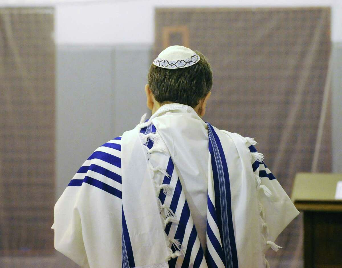 A man prays during the Chabad Lubavitch of Greenwich Yom Kippur service at Carmel Academy in 2012. Yom Kippur, also known as the Day of Atonement and the holiest day of the year for the Jewish people, will begin this year on the evening of Sept. 22 and ends on the evening of Sept. 23.