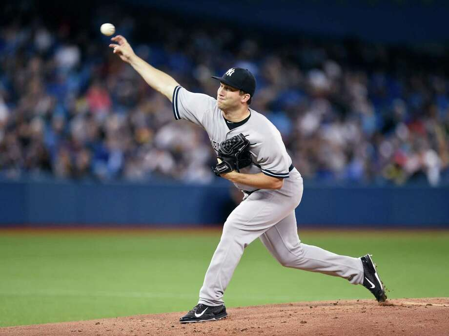 New York Yankees' starting pitcher Adam Warren works against the Toronto Blue Jays during first inning baseball game action in Toronto, Monday, Sept. 21, 2015. (Frank Gunn/The Canadian Press via AP) MANDATORY CREDIT ORG XMIT: FNG605 Photo: Frank Gunn / The Canadian Press