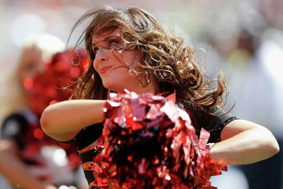 A Cincinnati Bengals cheerleader performs in the first half of an NFL football game against the San Diego Chargers, Sunday, Sept. 20, 2015, in Cincinnati. (AP Photo/Gary Landers) Photo: Gary Landers, Associated Press / FR171284 AP