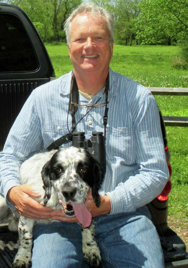 Milan Bull, the Connecticut Audubon Society's senior director of science and conservation, and his dog Edge will lead a hike Oct. 3 through the Aspetuck Land Trust's Haskins Preserve. Photo: Contributed / Contributed Photo / Westport News