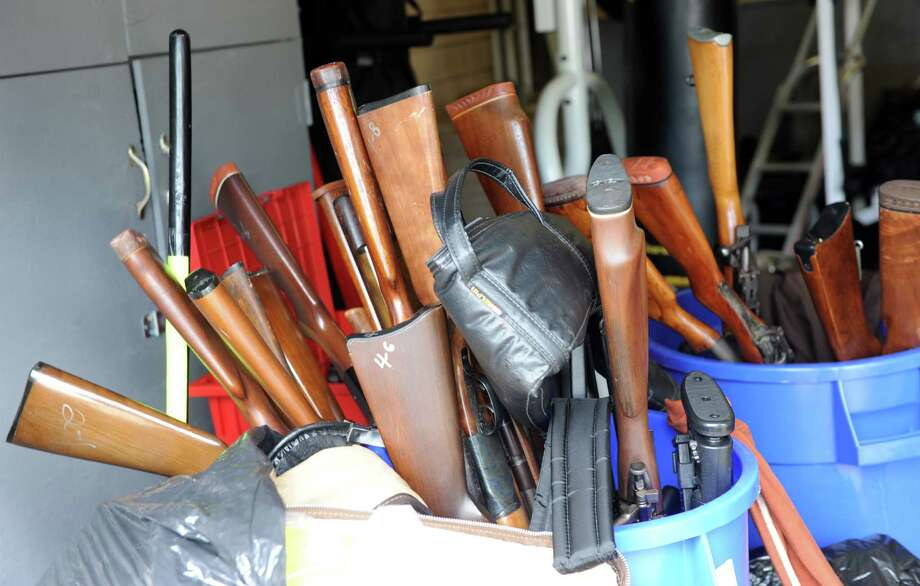Some of the more than 100 guns collected Saturday, July 18, 2015, during Bridgeport's Gun Buyback initiative Saturday, July 18, 2015, at the Police Department Community Services Division at 1395 Sylvan Ave. The Bridgeport Police Department offered up to $200 for a working handgun, up to $100 for a rifle and a weapon determined to be an assault rifle was eligible for up to $400. Photo: Autumn Driscoll / Hearst Connecticut Media / Connecticut Post