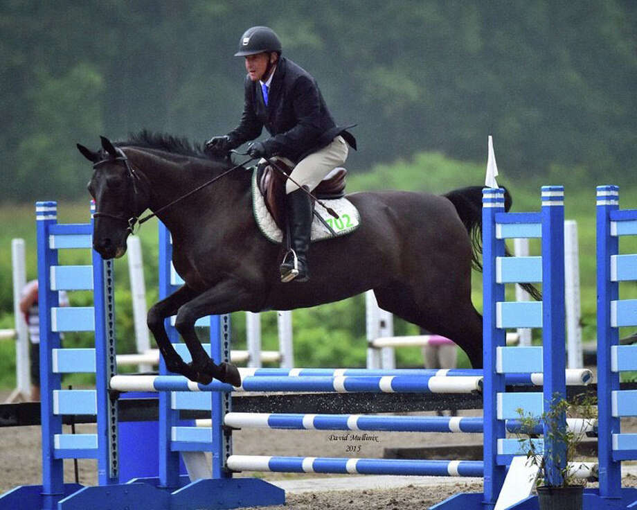 Westporter Bob Rose won the Adult Modified Hunter division of the Fairfield Westchester Professional Association in 2015 with his horse Black Gold. Photo: Contributed Photo / Westport News Contributed