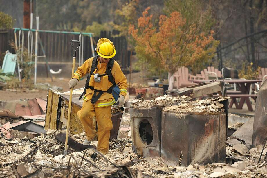 This file photo taken on Sept. 14 show firefighters searching the charred rubble after the Valley Fire tore through a residential area of Lake County. The fire ranks as the third most destructive in state history. Photo: Josh Edelson, AFP / Getty Images