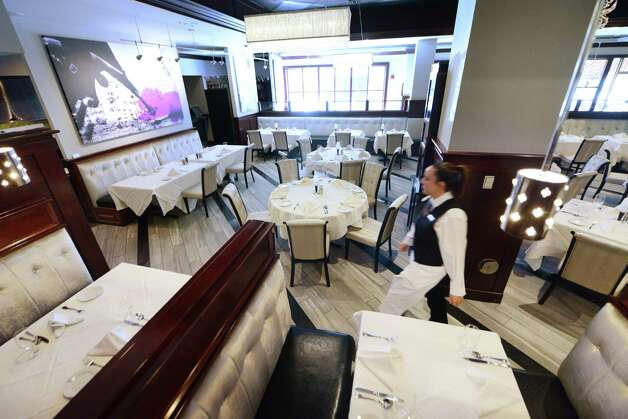 Updated interior at Angelo's 677 Prime Monday morning, Sept. 21, 2015, on Broadway in Albany, N.Y. Mazzone Hospitality spent $300,000 in renovations to its flagship steakhouse. The restaurant is celebrating its 10th anniversary this year. (Will Waldron/Times Union) Photo: Will Waldron / 00033444A