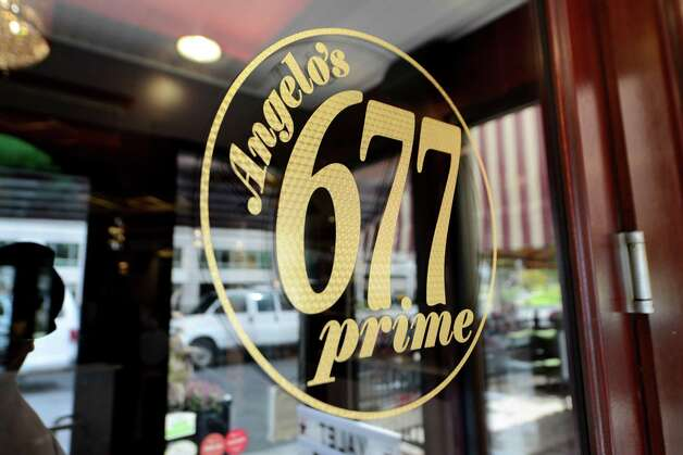 Door sign at Angelo's 677 Prime Monday morning, Sept. 21, 2015, on Broadway in Albany, N.Y. Mazzone Hospitality spent $300,000 in renovations to its flagship steakhouse. The restaurant is celebrating its 10th anniversary this year. (Will Waldron/Times Union) Photo: Will Waldron / 00033444A