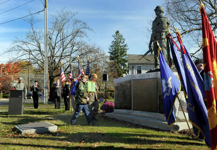 Paul Schlemmer, left, commander of VFW Post 149 and Mayor Mark Boughton, place a wreath at the Vietnam War monument at at Rogers Park on Nov. 13, 2014, during a Vietnam War memorial service in Danbury, Conn. Photo: Carol Kaliff / Carol Kaliff / The News-Times