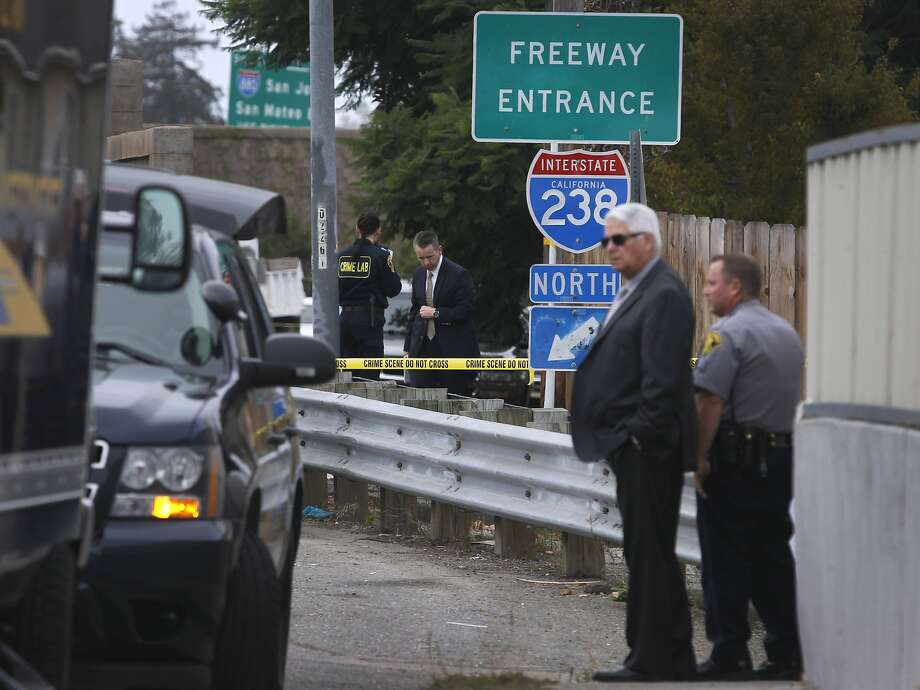 Alameda County Sheriffs investigators gather evidence after a car jacking suspect was shot and killed during a shootout with deputies near East 14th Street and the on-ramp to northbound I-238 in San Leandro, Calif. on Tuesday, Sept. 22, 2015. Photo: Paul Chinn, The Chronicle