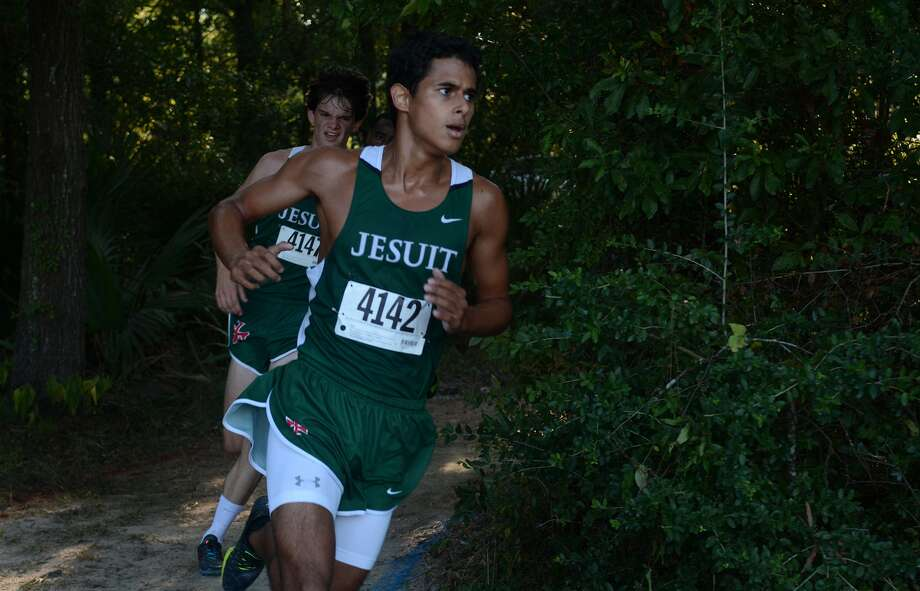 Strake Jesuit's Hugo Gonzalez (4142) and teammate Andrew Hebert (4147) compete during the boys varsity race at the Andy Wells Invitational at Kingwood High School on Sept. 19, 2015. (Photo by Jerry Baker/Freelance) Photo: Jerry Baker, Freelance