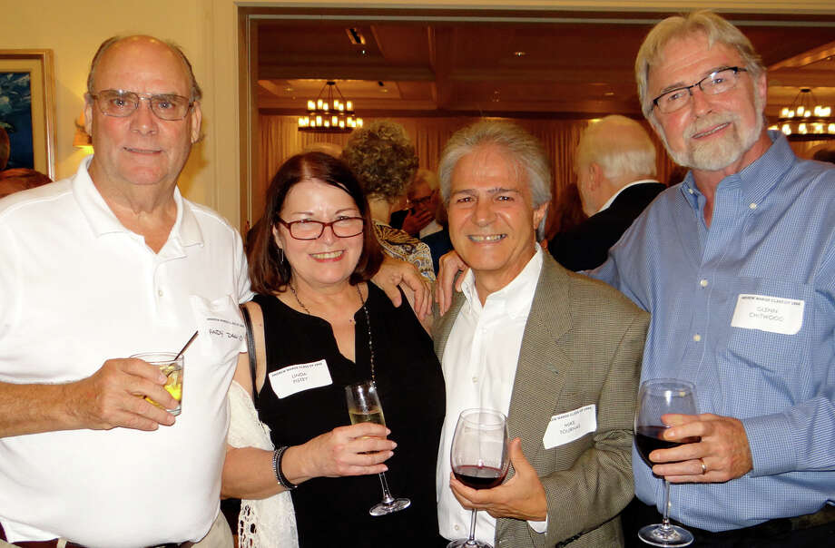 Andy Dawid, Linda Pistey, Mike Tournas and Glenn Chitwood catch up at the Andrew Warde High School Class of '66 reunion Saturday. Photo: Mike Lauterborn / For Hearst Connecticut Media / Fairfield Citizen