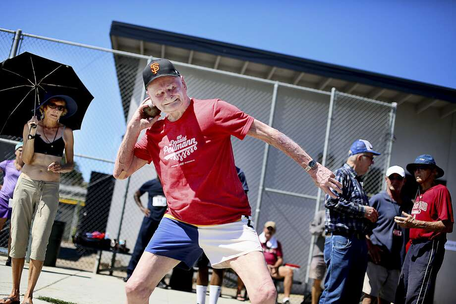 Don Pellmann, a 100-year-old Santa Clara man, puts the shot while competing in the San Diego Senior Games at Mesa College in San Diego. His mark in the event was one of five age-100 world records he set at the games. Photo: Sandy Huffaker, New York Times