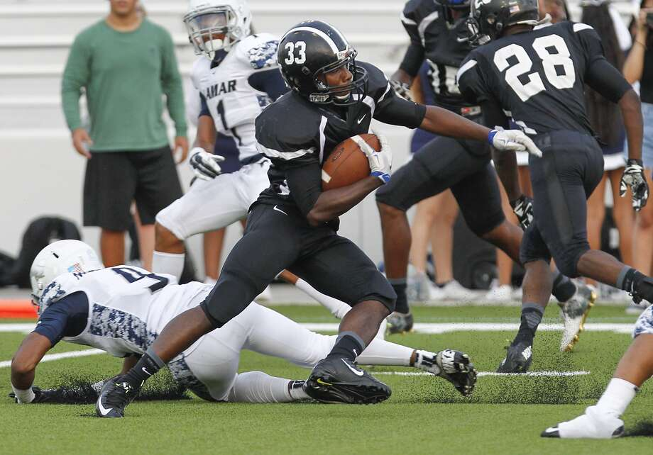 Jermelle East of Westside dodges Lamar Consolidated defenders as the two teams faced off in the first game of the season at Delmar Stadium on August 27, 2015. Photo: Diana L. Porter, Freelance / © Diana L. Porter