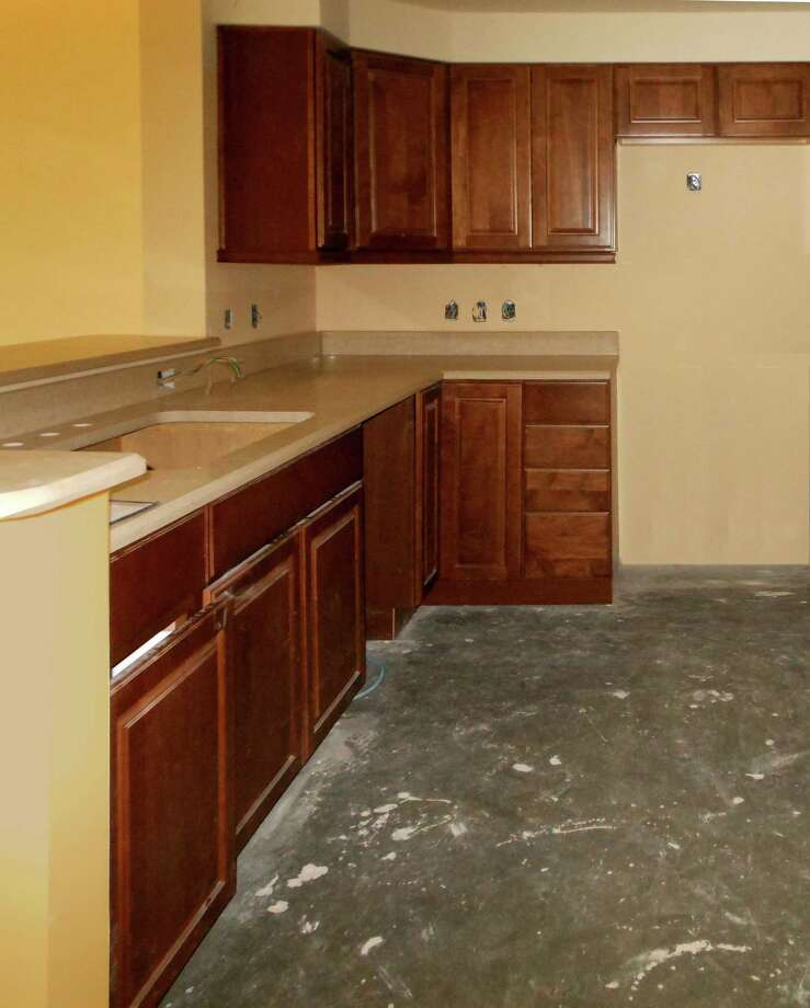 Installation of custom-wood cabinetry is under way in the kitchens of the new East Tower of Brazos Towers at Bayou Manor.
