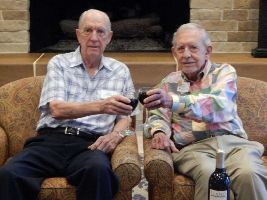 Eagle's Trace residents Tom Snodgrass, left, and Patrick Gibbons are active members of the Soaring Eagles Wine Club.