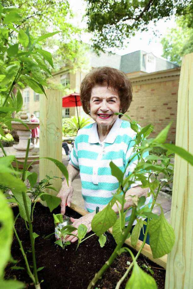 Treemont resident Camella Scalise tends to the community's pesticide-free, organic garden.