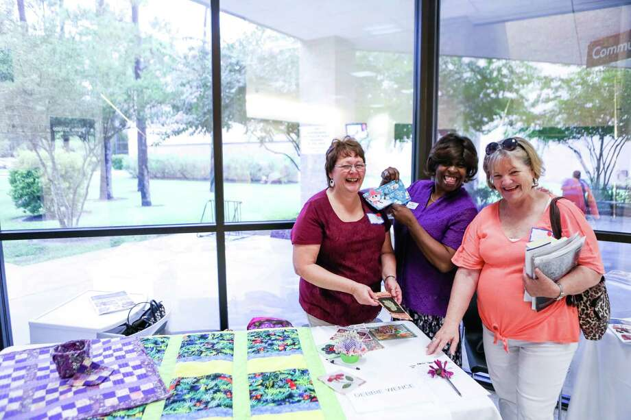 From left, Debbie Wence, Rita Washington and Carol Roberts inquire about a quilting class at the Academy for Lifelong Learning open house.