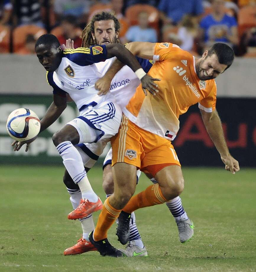 Houston Dynamo midfielder Brad Davis, right, and Real Salt Lake defender Demar Phillips, left, tangle during the first half of an MLS soccer game, Saturday, Sept. 12, 2015, in Houston. (AP Photo/Eric Christian Smith) Photo: Eric Christian Smith, FRE / FR171023 AP