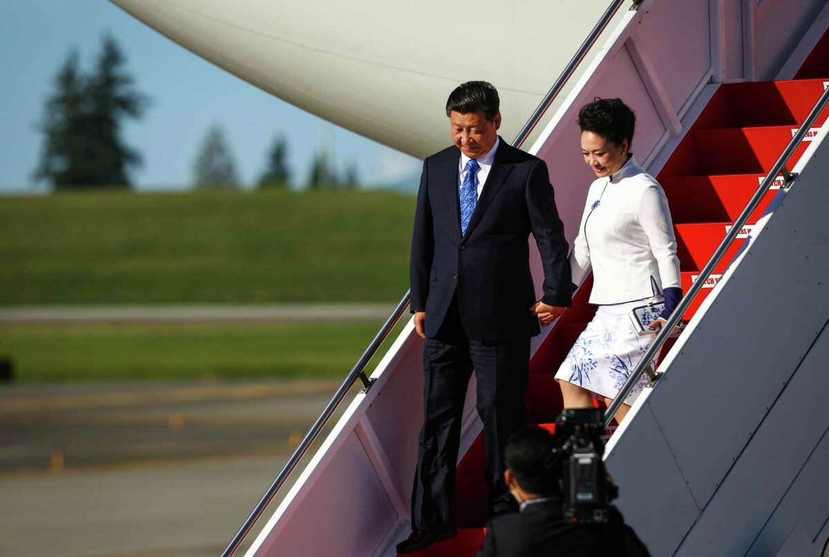 Chinese President Xi Jinping and his wife Peng Liyuan arrive in the Seattle area as they depart an Air China, Boeing 747. The Chinese leader will be in the Seattle area visiting with government and business leaders. Photographed at Paine Field on Tuesday, September 22, 2015.