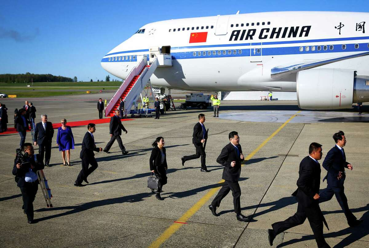 Officials run on the flightline as Chinese President Xi Jinping arrives in the Seattle area. The Chinese leader will be in the Seattle area visiting with government and business leaders. Photographed at Paine Field on Tuesday, September 22, 2015.