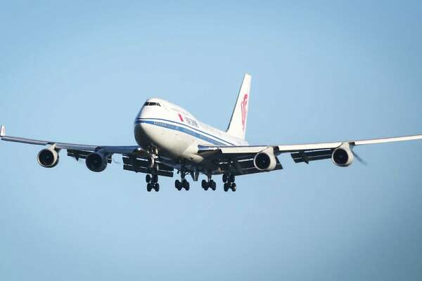 Chinese President Xi Jinping arrives in the Seattle area aboard an Air China, Boeing 747. The Chinese leader will be in the Seattle area visiting with government and business leaders. Photographed at Paine Field on Tuesday, September 22, 2015.