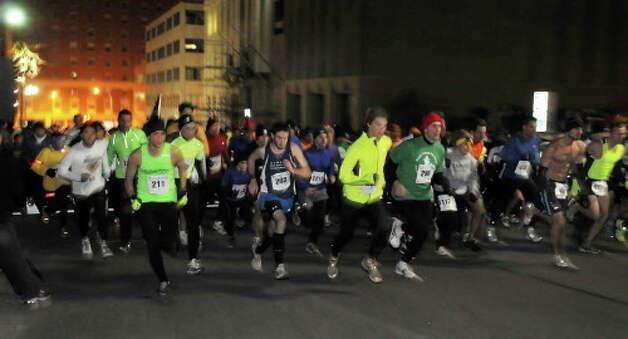 Runners at the start of the 15th Annual Last Run 5K  race in Albany Saturday Dec. 17, 2011.    (John Carl D'Annibale / Times Union) Photo: John Carl D'Annibale / 00015785A