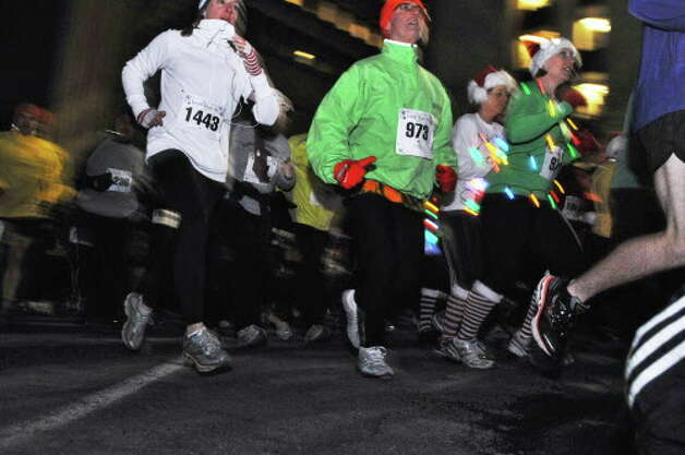 Runners in the 15th Annual Last Run 5K  race in Albany Saturday Dec. 17, 2011.    (John Carl D'Annibale / Times Union) Photo: John Carl D'Annibale / 00015785A