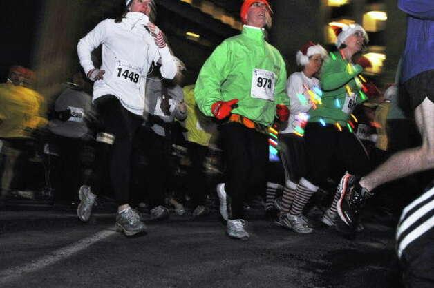 Runners in the 15th Annual Last Run 5K  race in Albany Saturday Dec. 17, 2011.    (John Carl D'Annibale / Times Union) Photo: John Carl D'Annibale / 00015785A