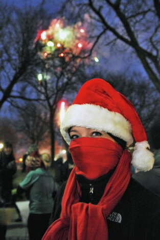 Runner Jessica Pollack of Clifton Park awaits the start of the 15th Annual Last Run 5K  race in Albany Saturday Dec. 17, 2011.    (John Carl D'Annibale / Times Union) Photo: John Carl D'Annibale / 00015785A