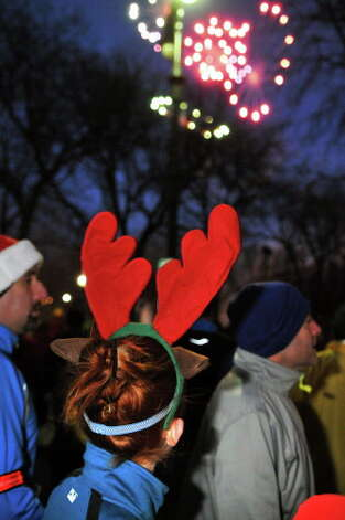 Runners watch fireworks display as they await the start of the 15th Annual Last Run 5K  race in Albany Saturday Dec. 17, 2011.    (John Carl D'Annibale / Times Union) Photo: John Carl D'Annibale / 00015785A