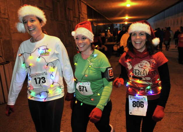 Runners Kate Coberg of Rotterdam, left, Tanya Scime of Rotterdam and Tara Patton of Troy before the the start of the 15th Annual Last Run 5K  race in Albany Saturday Dec. 17, 2011.    (John Carl D'Annibale / Times Union) Photo: John Carl D'Annibale / 00015785A